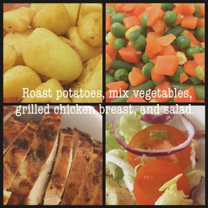Roast potatoes, mix vegetables, grilled chicken breast, and salad.